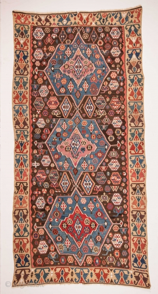 An Anatolian Kilim with an epic like ananymous stroy woven into it. Cut and Shut in the middle vertically 161 x 334 cm / 5'3'' x 10'11''