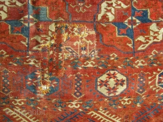 First Half 19th Century Tekke Turkmen Main Carpet In distressed condition with holes, old repairs and original selvages missing.  Both ends have been secured; in relatively clean condition.