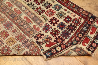 Marasali rug Late 19th Century with great colours on an ivory field.  Obviously more of a fragment due to missing quite a lot of borders on one side.  Has a  ...