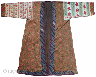 "Uzbek Silk Robe. Fourth quarter 19th century. Handwoven silk shohi; Russian roller-printed cotton lining fabrics; adras ikat facings; Russian yarn dyed stripes on cuffs and hem; loop manipulation handwoven silk trim. 52""  ..."