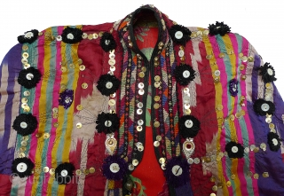 Woman's Jelak. Samarkand region, Uzbekistan. Silk atlas; silk cross stitch hand-embroidery; black machine-embroidery; metal spangles; pearl, glass, & plastic buttons; tiny glass beads. Hand-braided trim on false sleeves. Lined with printed cotton.  ...