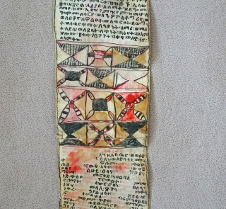 This is a traditional Antique Coptic Christian scroll from the Oromo people of Ethiopia. Painted on Vellum (processed animal skin) and using a special black and red ink, the text is in  ...