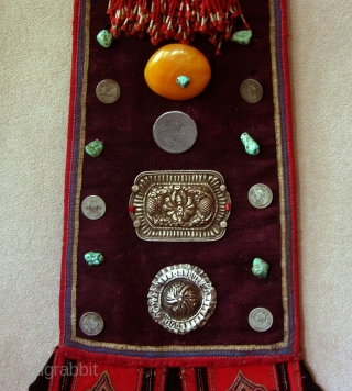 T151 Originally part of a full sized Tibetan adult costume, this piece was cut down to complete a childs festival costume. Decorated with turquoise, coins, tassels and silver ornaments, this type of  ...