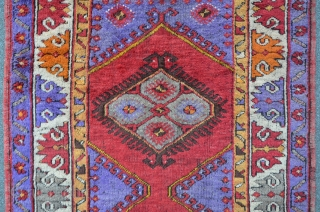 Central Anatolian Carpet with purple ground, 182 x 111 cm, corroded brown. A fascinating colorful piece.
