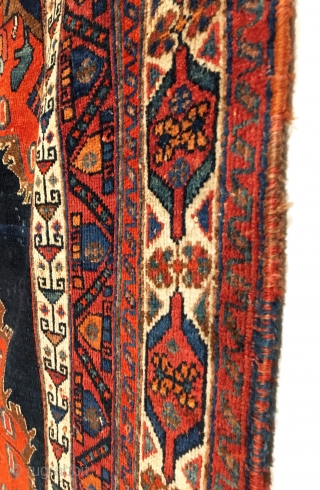 Antique Afshar Rug. Last Quarter 19th Century. Classic vase design. On the dark indigo field sit two opposing flower filled vases at top and bottom. Great condition. Original four sides. Kilim ends.  ...