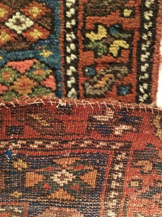 Antique Kurdish Long Rug. Last Quarter 19th Century. 21 Colorful Rows of archaic dragon motifs. Some pile loss to top left. Old darning visible across bottom. Original braided top and selvage. 3'11  ...