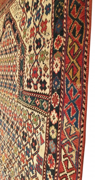 Antique Shirvan Prayer Rug. White Ground. Dated 1295 = Circa 1879. Hexagonal lattice enclosing colorful small flower petals. Note: Field design continued above pentagonal mihrab. Very good condition considering age with even  ...