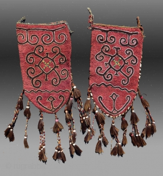 "Kyrgyz ""Ok Bosh"" (wool felt with wool/cotton embroidery), Central Asia,   19th C.,  1'2"" x 2'7"" (excluding tassels)