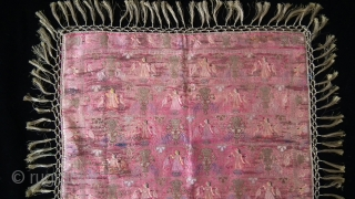A lovely piece of Indian brocade work, elephants and birds on a pink silk base. Fragile areas but secured with silk backing.  Silk and metal twine.  Size: 60x60cm.