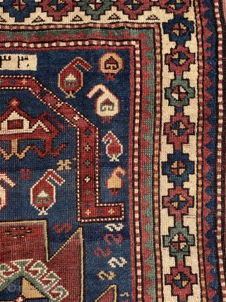 Antique Kazak dated rug low pile but overall it is in good condition. Size is 148 x 86 cm