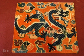 circa 1925 ,Small sitting or meditation Rug with Dragon holding precious jewels in orange background. Good Condition and no repair. feel free to ask more about it.