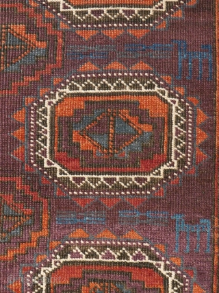 "# 1127 Rare symmetrically knotted rug, ""Baluch Tradition"", with Turkmen guls, 109/156 cm, Khorasan (?), late 19th century, unusual palette of secondary colours (Orange, Aubergine, Green), all of natural origin, contrasted by  ..."