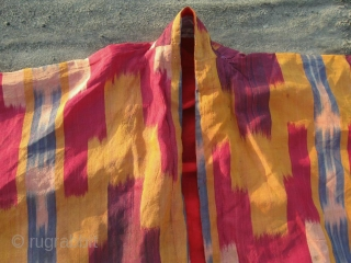 Antique Uzbek silk Ikat coat. In very good condition, without damaged area, holes.