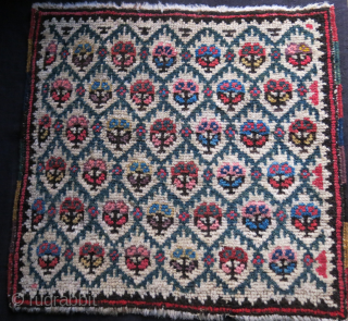"""Transcaucasian pile bag face, saturated colors, some old selvage repair. Circa 19th. Size- 18"""" X 17"""" -- 46 cm X 43 cm"""