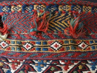 """Qashkai single side of a double bag. sumak weave with saturated natural colors, original goat hair side wrapping with closer loops. Circa 1900 size: 24"""" X 20"""" - 61 cm X 51  ..."""