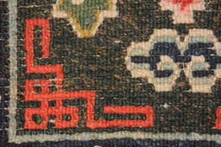 Beautiful richly coloured naturally dyed Tibetan small seating carpet or mat. The three dimensional 'Greek T' main border encloses an inner secondary border with crosses that mimic the tie-dyed tigma pattern much  ...