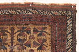 Old camel ground baluch rug with an unusual and attractive ivory serrated leaf border. Overall fair condition with low pile and some wear as shown. All natural colors. Could use a wash.  ...
