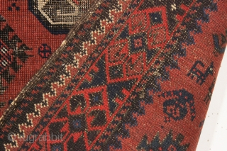 antique little baluch rug. Older example of this interesting type. Thin with wear and heavily oxidized browns as shown. Difficult to photograph but guaranteed all good natural colors. Could use a good  ...