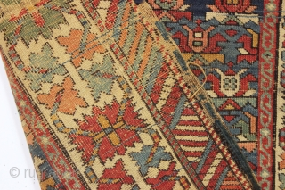Old caucasian rug, possibly kazak, with unusually good colors but in distressed condition. The large range of natural colors contains lovely greens and blues and a very fine old apricot orange. Very  ...