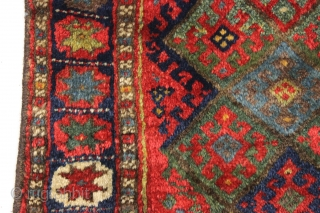 "antique jaf kurd bagface with thick high pile and beautiful saturated colors. Highest quality glossy wool. Unusual wide format and an attractive ""star"" border. All natural colors featuring lovely greens. One of  ..."