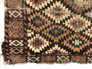 Antique unusual turkman rug fragment, perhaps chodor, with a tight lattice of ashik guls arranged in diagonal color rows on a dark brown ground. Persian knotted open to the right. Appears to  ...