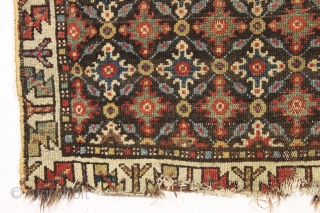 early northwest persian, or perhaps veramin rug remains. Not for everyone but to me a fascinating archaic field design with what I assume are cloudband derived motifs. Beautiful natural colors. As found,  ...