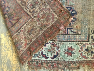 Old northwest Persian or Kurdish rug. Interesting field design and unusual border. As found, very very dirty with wear and edge damage as shown. Priced accordingly. Appears to have all natural colors.  ...