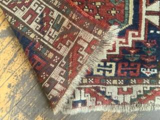Antique kazak or Karabaugh rug. Interesting field. Fair condition. Even low pile. Good selvages. End loss as shown. Needs a wash. Charming little rug. Late 19th c. 3'3 x 5'5""