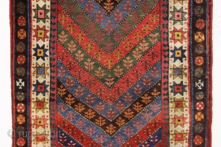 antique kurdish rug in good condition with a bold design and superb colors. Genuine old rug from a New England home. Overall fleecy wool and thick good pile with only slight wear.  ...