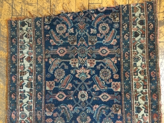Back room storage cleanout. Old bidjar rug fragment. Dirty with wear. About 3' x 5'