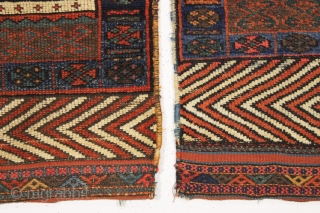 antique pair of northwest persian or kurdish bagfaces. Rare to find an original and interesting pair with unusual designs featuring eye catching skirt panels. From a New England home. Washed and clean.  ...