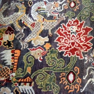 This is an exquisite vintage Tibetan rug which is approximately 50 years old. The rug was hand knotted on a traditional wooden loom using age-old techniques and 100% natural dyes. It was  ...