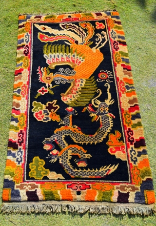 This is a semi-vintage, collectible Tibetan rug that is approximately 35 to 40 years years old. The rug was hand knotted on a traditional wooden loom using age-old techniques and 100% natural  ...