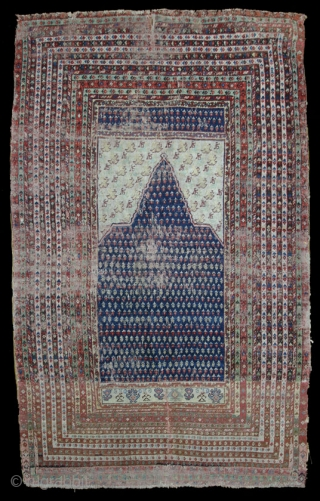 Anatolian Prayer rug,W/W,210X145 cm. Two unusually large fragments sewn together before the selvages were fixed. Former turkish owner attributed it to Gördes, but a unique design like this does not fit into  ...