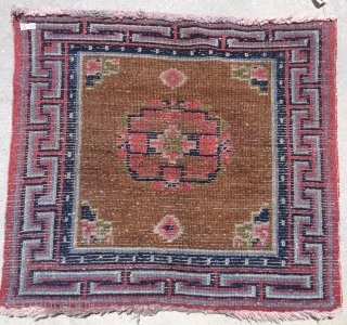 "Older Tibetan Sitting Rug: 33"" x 29"".  All over pile with wool warp and weft. Larger knot structure may indicate an earlier piece c1900. Believe dyes are all natural."