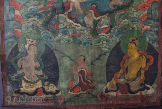A very unusual Nepalese or perhaps East Tibetan 19th century Buddhist thangka of Maha Cundi with eighteen arms seated on a green dragon and holding a basket of jewels with four aspara  ...