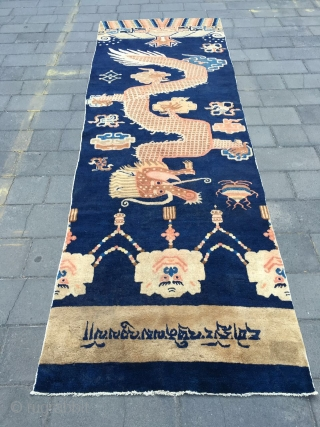 #1638 Ningxia carpet, blue background with the dragon veins were warpped on the pillar, the front part and back part of the dragon were connected and rose up in helix shape to  ...