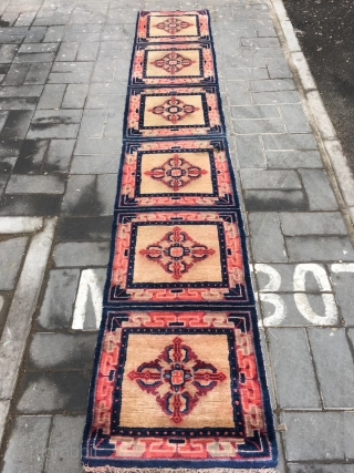 "Ningxia runner carpet, six joined mats, light camel background with Buddha turns wheel veins. Very good age and condition.size 355*60cm(138*23"")"