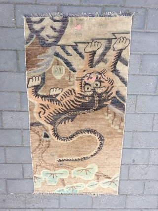 #1715 Baotou rug, It was produced in Baotou area in Inner Mongolia, camel background with lively tiger in mountain pattern. good age and quality, size 142*71cm(55*28'')