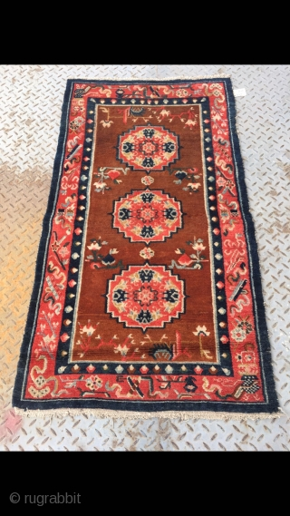 Tibetan rug, group flower pattern with Chinese Bogu veins selvage. Good age and condition. Size 138*75cm(53*29)