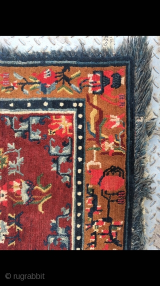 "Tibetan rug, red background with colorful flower and grass pattern. Good age and condition. Size 165*88cm(64*34"")"