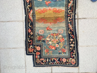 "#2049 Tibet horse saddle, moon blue background with group flowers pattern, around eight treasures of Buddha selvage. Good age and quality. Wool warp and weft. Size 123*62cm(48*24"")"