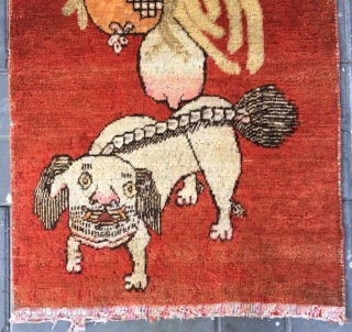 """Chinese Xinjiang Khotan rug, red background with very rare lion pattern. About 1930. Good condition. Size 75*146cm(29*58"""")"""