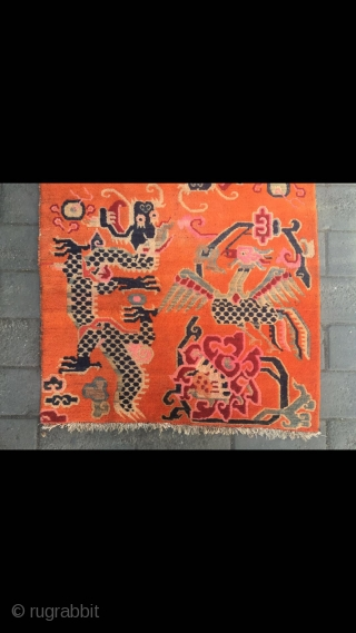 """#2063 Tibet rug, orange background with double dragon and phoenix pattern, around beautiful peony and lucky clouds veins. Good age and quality. Size 158*90cm(62*35"""")"""