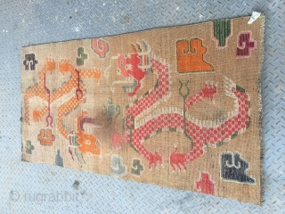 #1651 Tibet rug, light camel background with lively double dragon and lucky cloud pattern. good age and quality. wool warp and weft, size 165*91(64*35'')
