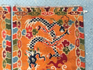 #1652 Tibet dragon rugs, very rare a pair of dragon rugs, orange background with double lively dragon pattern, lucky cloud and water selvage. good age and quality.wool warp and weft.size 156*84(61*33'')   ...