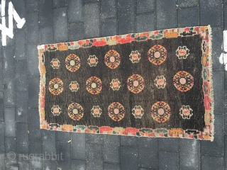 #1657 Tibet rug, Brown background with flower group pattern, colorful lucky cloud selvage.good age and quality. size 142*80cm( 55*31)