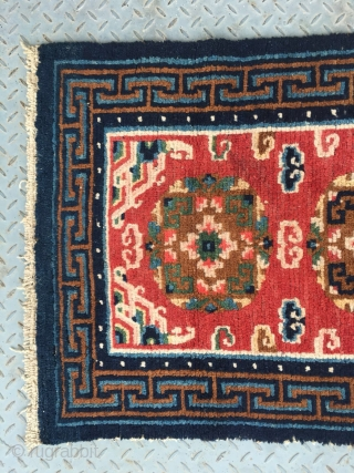 "Tibet rug, red color, three medallions flower pattern around lucky cloud veins. good colors and condition, good age , 4 rows of knots rewoven at one end. Size 133*73cm(52*28"")"