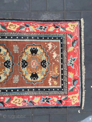 "Tibet rug, camel background with three group flowers pattern, around red color full flower selvage. Size 152*83cm(59*32"") wool warp and weft. Good age"
