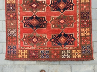 #1773 Xinjiang rug, It was procued in Khalkhas in Xinjiang, red background with abstract gourp flower pattern, coloful pomegranate seed veins selvage. camel wool warp and weft. good age and quality.size 210*125cm(82*49'')